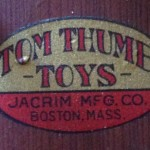 Jacrim Tom Thumb Toys Logo